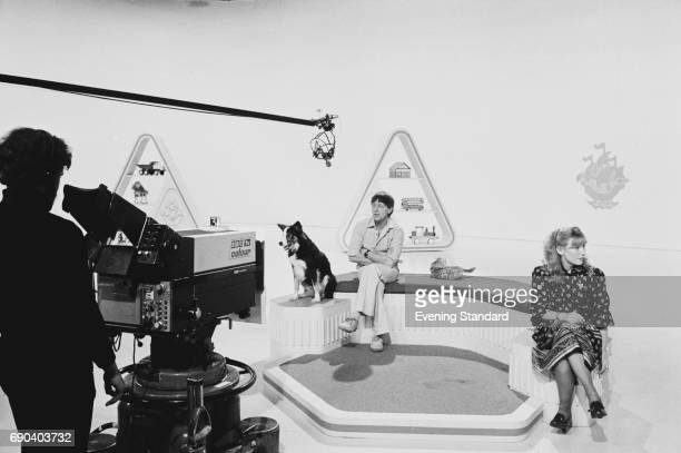 Blue Peter presenters in the studio Shep the dog John Noakes and Lesley Judd 11th November 1977
