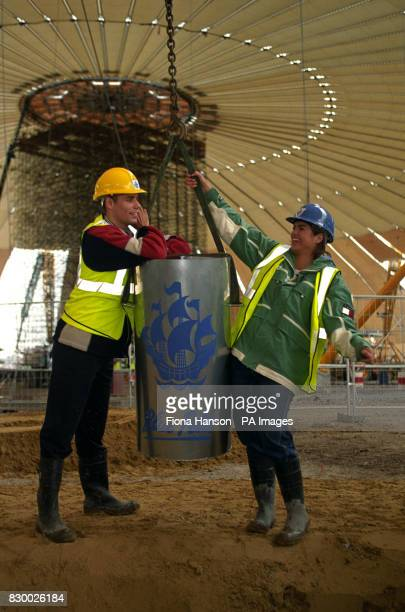 Blue Peter presenters Richard Bacon and Katy Hill poes for the media with the Blue Peter time capsule before its is buried in the National Identity...