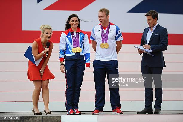 Blue Peter television presenter Helen Skelton controls her skirt in the windy conditions as Gold medal winning Paralympian Gold medal winning cyclist...