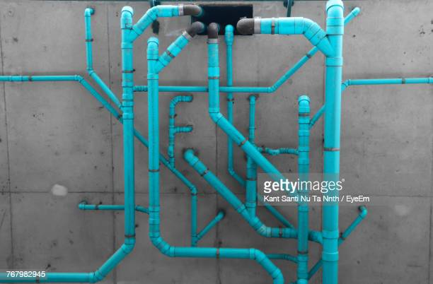blue pipes on wall - pipes stock pictures, royalty-free photos & images