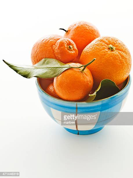 blue plaid orange bowl 1 - navel orange stock photos and pictures