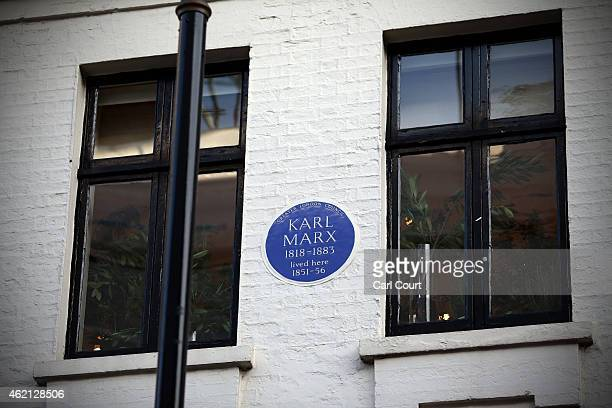 A blue plaque announcing previous occupancy by Karl Marx is seen on the wall of a building in Soho on January 16 2015 in London England A growing...