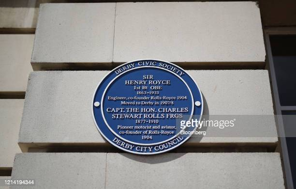 Blue plaque paying tribute to Rolls-Royce Holdings Plc co-founders Henry Royce and Charles Rolls hangs from the company's former facility that was...