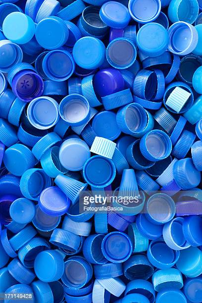 Blue plastic caps background