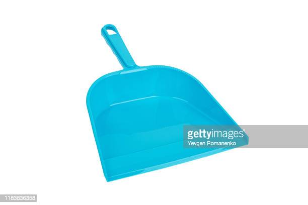 blue plastic dustpan isolated on white background - dustpan and brush stock pictures, royalty-free photos & images