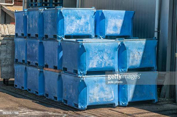 blue plastic storage boxes for storing fish waste - industrial storage bins stock pictures, royalty-free photos & images