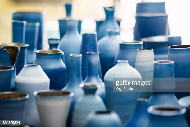 blue pottery works in okinawa - ceramic stock photos and pictures