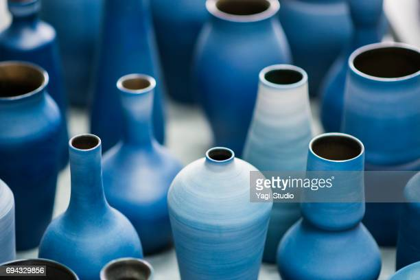 blue pottery works in okinawa - craft product stock pictures, royalty-free photos & images