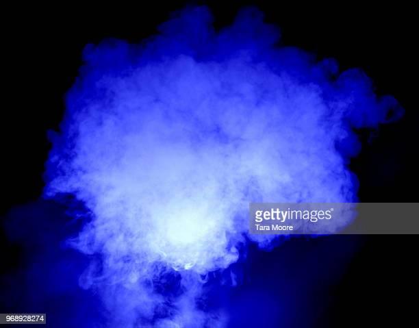blue puff of smoke - natuurgeweld stockfoto's en -beelden