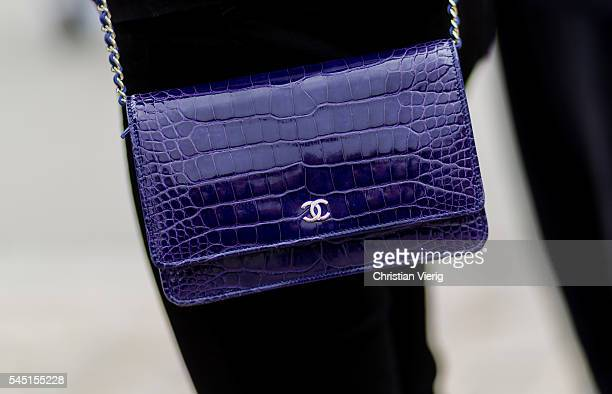 A blue purple Chanel bag outside Chanel during Paris Fashion Week Haute Couture F/W 2016/2017 on July 5 2016 in Paris France