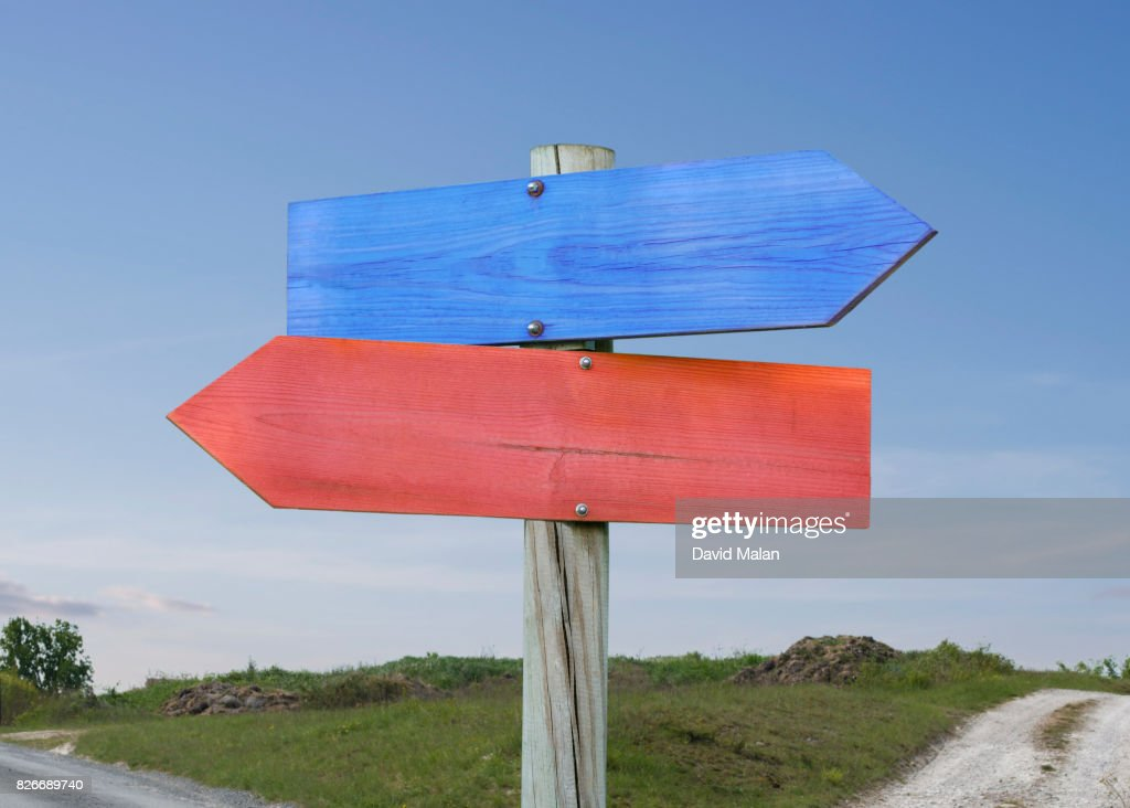 Blue & red direction signs. : Stock Photo