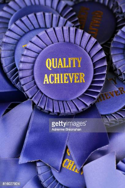 blue ribbon for quality achievement - blue ribbon stock photos and pictures