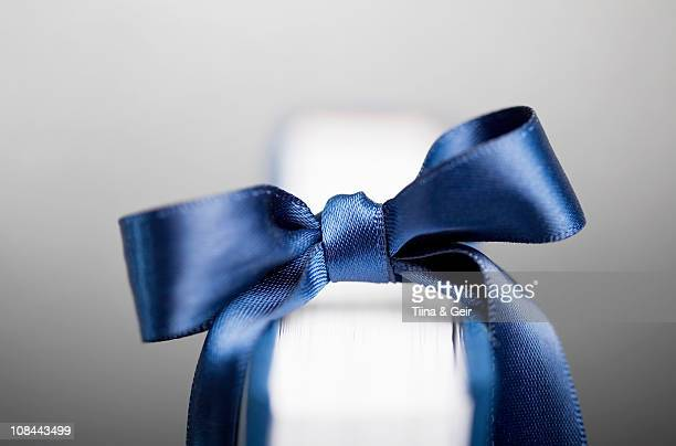Blue ribbon on book