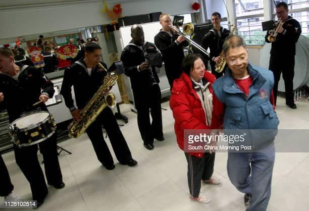 Blue Ridge Navy's 7th Fleet Band performs for members of Fu Hong Society as part of their community service projects during the ship's visit to Hong...