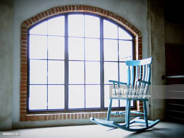 Blue Rocking Chair By Window