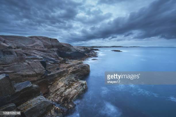 blue rocky coastline - rocky coastline stock pictures, royalty-free photos & images