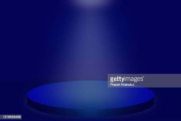 blue round stage background with downlight, dark background - winners podium stockfoto's en -beelden
