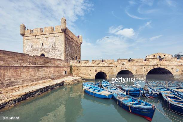 Blue rowing boats moored at the Citadel, Essaouira, Morocco