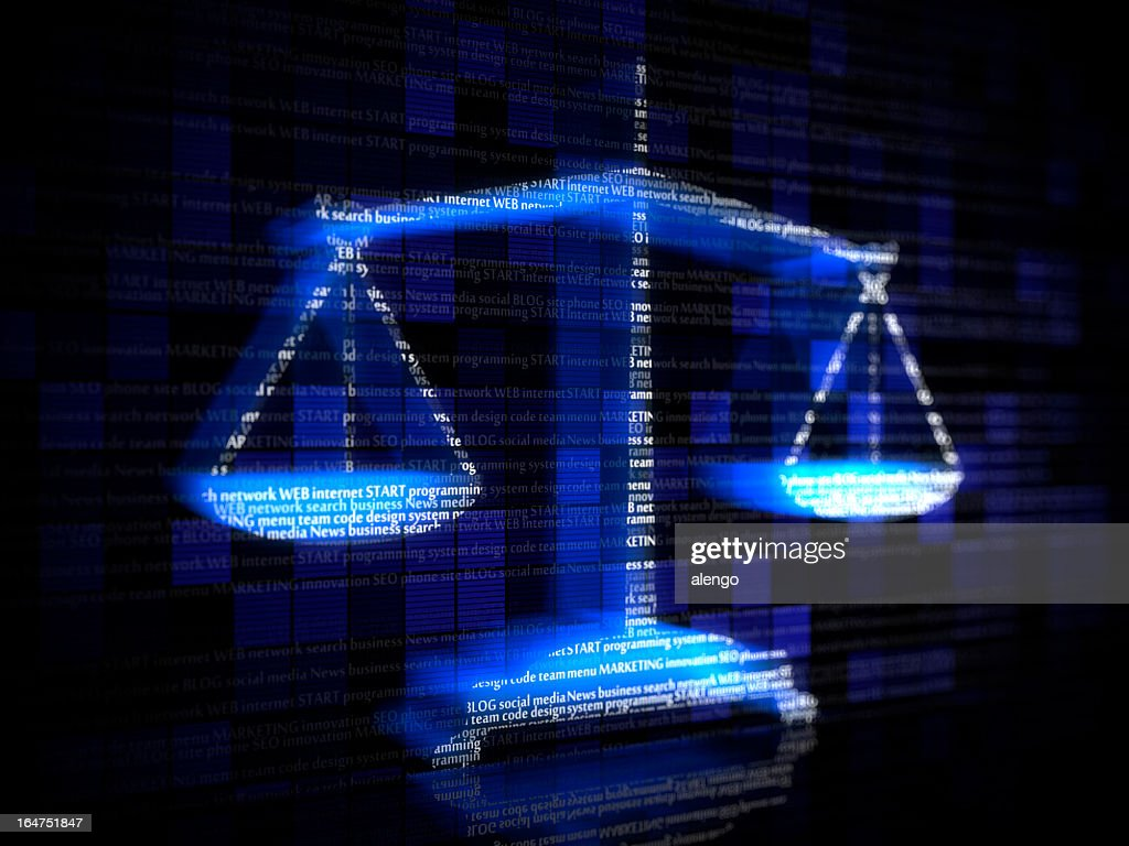 Blue scales with computer coding terms : Stock Photo