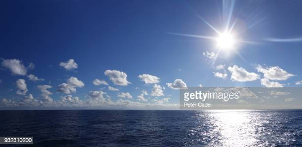 blue sea horizon, clouds and sun - horizon over water stock pictures, royalty-free photos & images