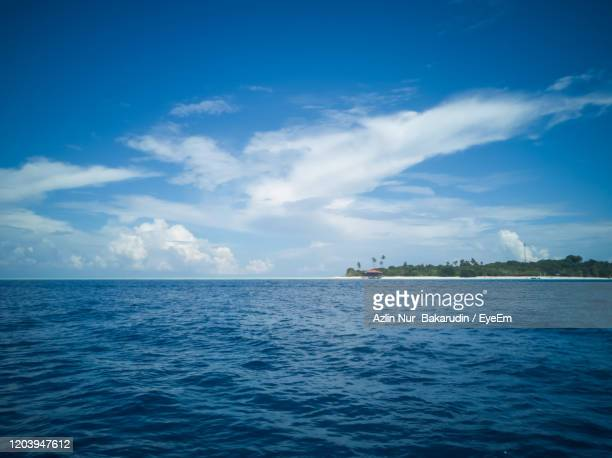 blue sea under a beutiful sky. dark blue and turquoise in semporna islands, borneo, sabah. - midday stock pictures, royalty-free photos & images