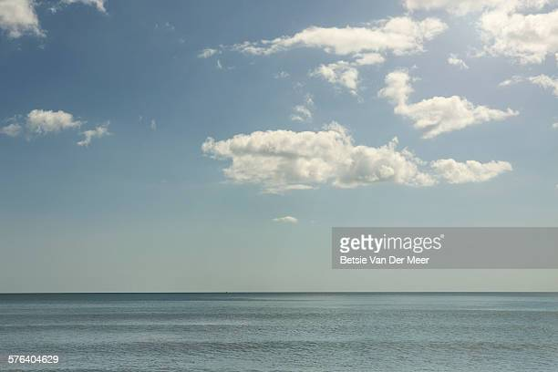 Blue sea with clouds and sunshine