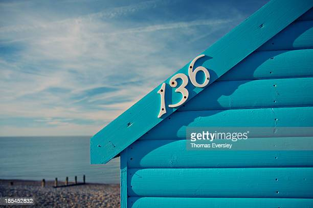 Blue seaside beach hut on the Kent coast in England.