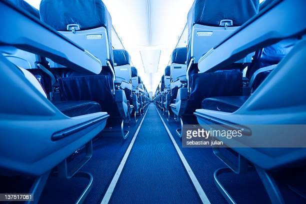 blue seats at inside an aircraft