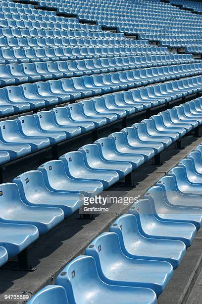blue seats in stadium - empty bleachers stock photos and pictures
