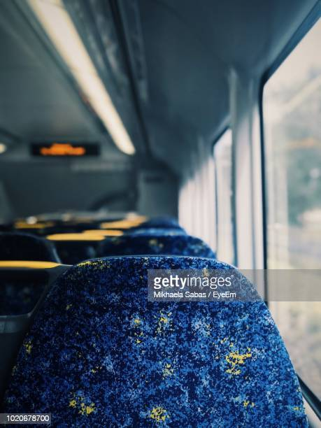 blue seats in train - vehicle seat stock pictures, royalty-free photos & images