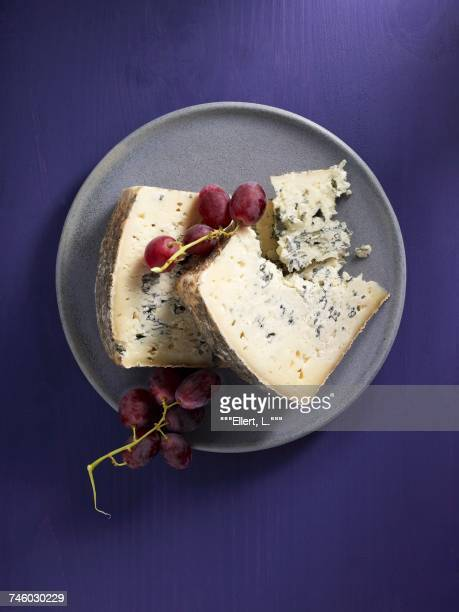 Blue sheeps cheese and red grapes