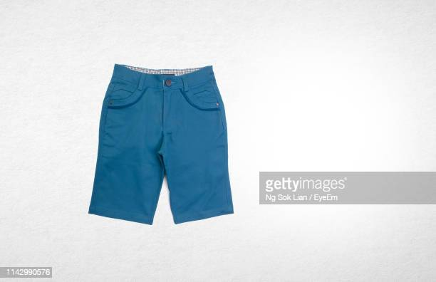 blue shorts against white background - shorts stock pictures, royalty-free photos & images
