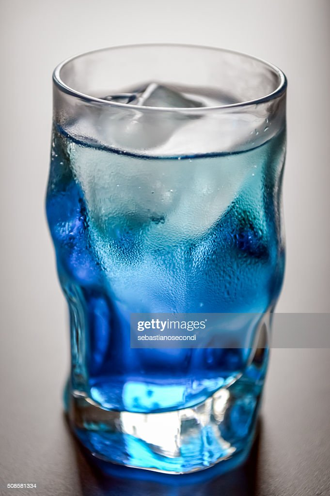 blue shot glass with ice and condensation : Stock Photo