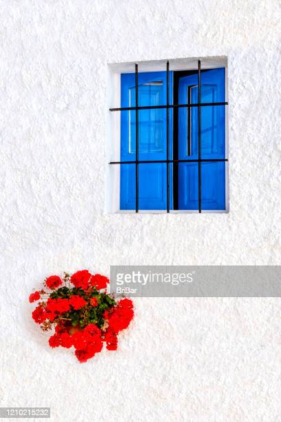 blue shuttered window - spanish culture stock pictures, royalty-free photos & images