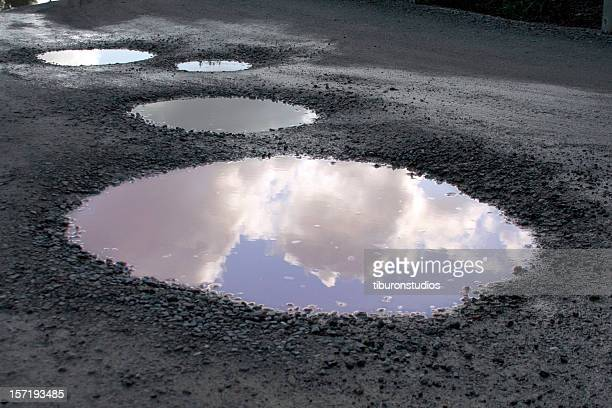 blue skies reflected after the rains - puddle stock pictures, royalty-free photos & images