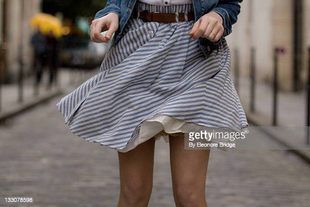 blue skirt in wind - skirt blowing stock photos and pictures