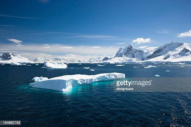 Blue sky above sea with icebergs