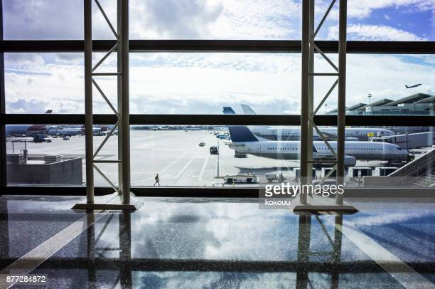 blue sky and airplane seen from airport. - passenger boarding bridge stock pictures, royalty-free photos & images