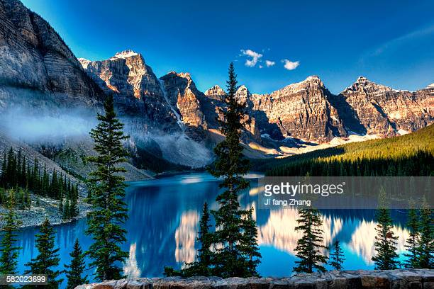 blue sky and blue water at moraine lake - moraine lake stock pictures, royalty-free photos & images