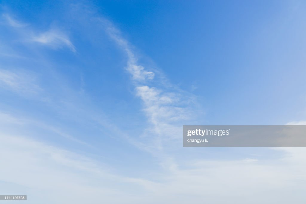 blue sky and clear ocean; Clouds In Blue Sky : Stock Photo