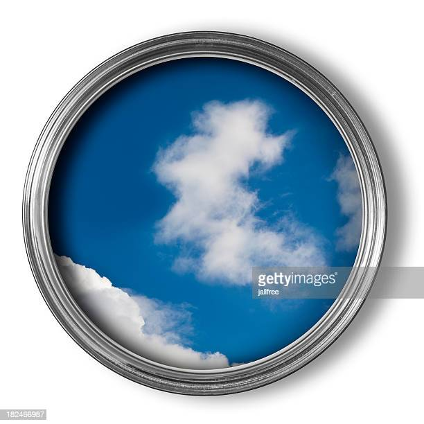 Blue sky and clouds in an open tin of paint