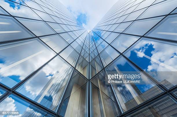 Blue sky and clouds reflections on a glass building