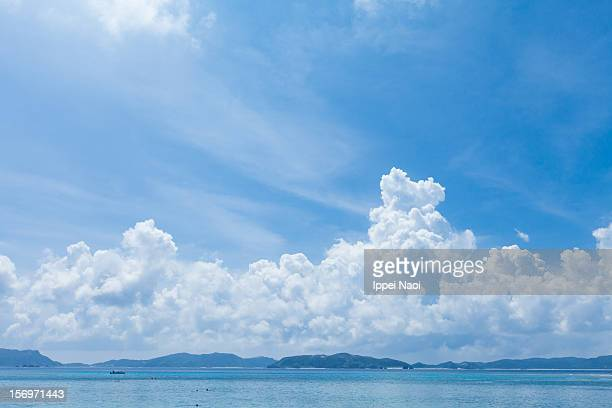 Blue sky and cumulonimbus clouds over tropical sea