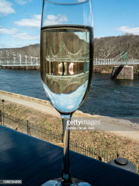 Blue sky and fluffy white clouds refracted through Champagne