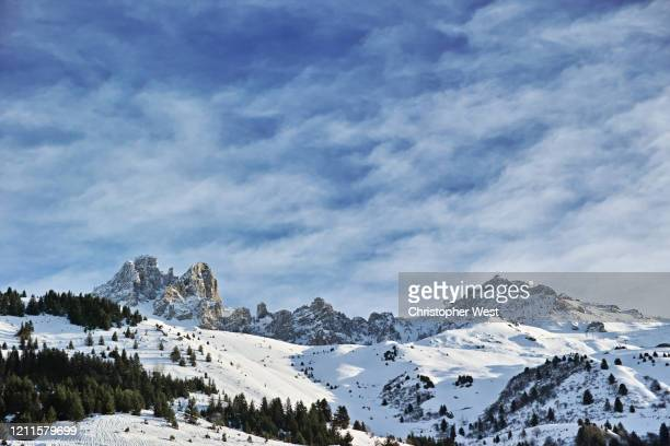 blue sky and mountain clouds - courchevel stock pictures, royalty-free photos & images