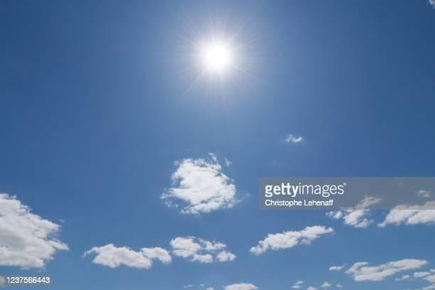 blue sky and sun over france at the start of the drought 2020 - värmebölja bildbanksfoton och bilder