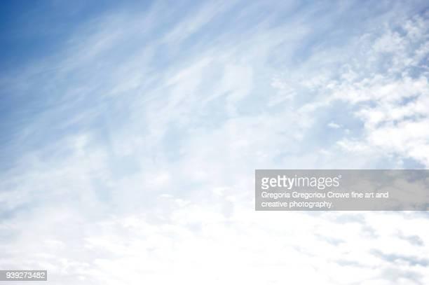 blue sky and white cloud - gregoria gregoriou crowe fine art and creative photography. photos et images de collection
