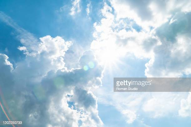 blue sky and white clouds background. clouds in the blue sky - sunlight stock-fotos und bilder