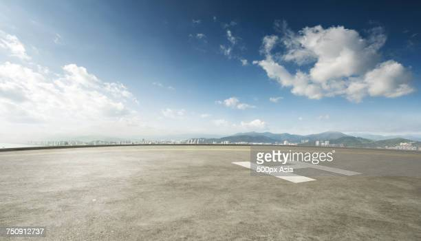blue sky and white clouds over empty helipad - image stock pictures, royalty-free photos & images