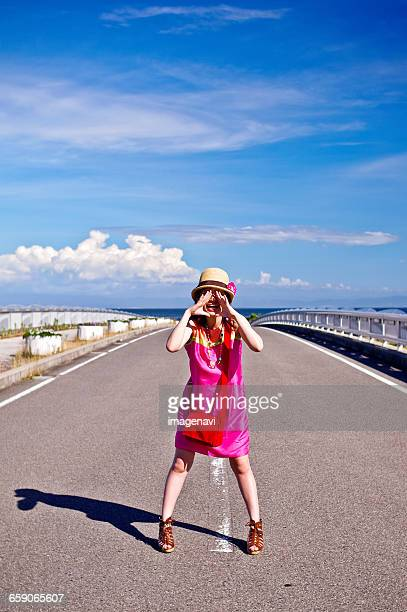 blue sky and woman - nur japaner stock-fotos und bilder